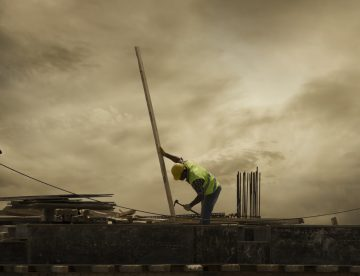 construction worker working alone on a roof