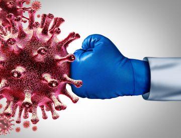 Blue boxing glove hitting the coronavirus